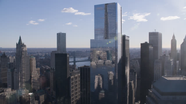 aerial of four world trade center. modern glass building. skyscrapers and high rise office or apartment buildings in downtown manhattan new york city skyline.