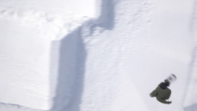aerial of freestyle snowboarder performing a big air jump - winter sport stock videos and b-roll footage