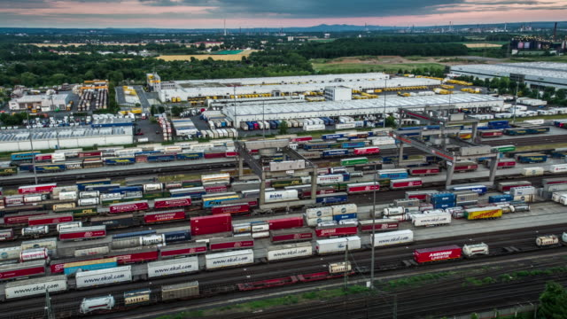 aerial of freight trains in freight yard - commercial land vehicle stock videos & royalty-free footage