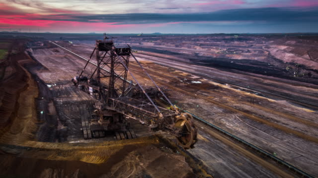Aerial of giant surface mine at dusk
