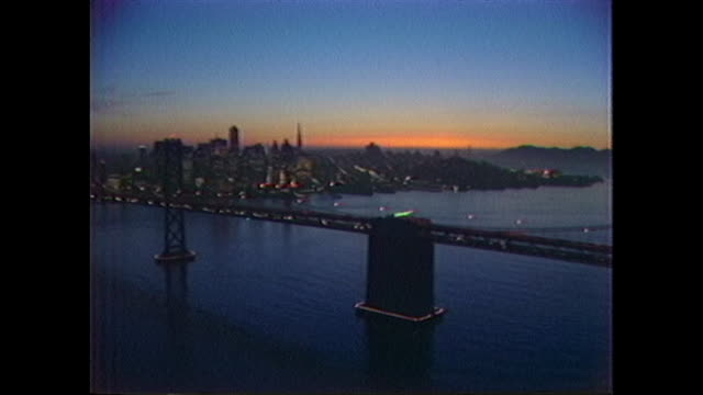 aerial of golden gate bridge and san francisco skyline at sunset. - san francisco bay area stock videos & royalty-free footage