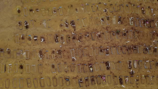 aerial of graves in cemetery in manaus, in the amazon, brazil, during coronavirus pandemic - latin america stock videos & royalty-free footage