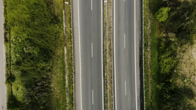 aerial of green countryside and highway - motorway stock videos & royalty-free footage