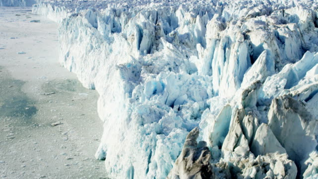 aerial of greenland arctic glacier and icebergs - icecap stock videos & royalty-free footage