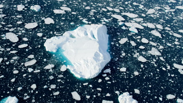 aerial of greenland arctic glacier and icebergs - ice floe stock videos & royalty-free footage