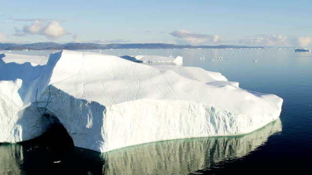 aerial of greenland arctic glacier and icebergs - climate stock videos & royalty-free footage