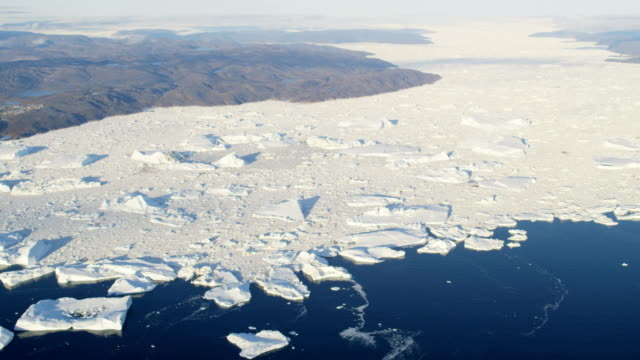 aerial of greenland arctic glacier and icebergs - icecap stock videos and b-roll footage