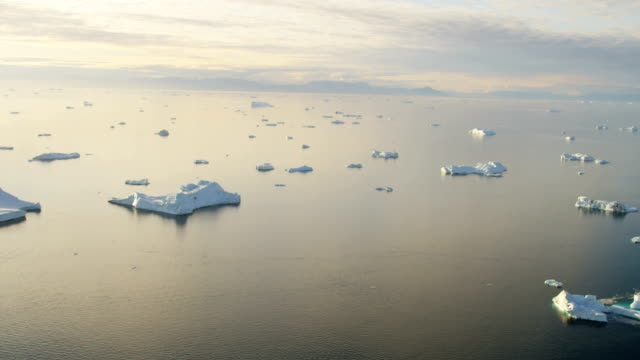Aerial of Greenland Arctic Glacier and icebergs