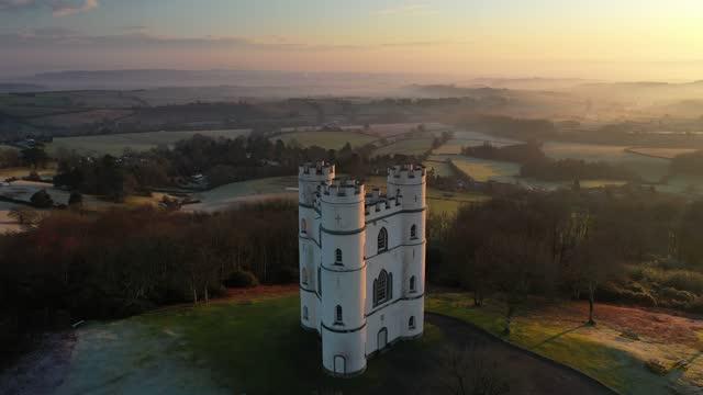 aerial of haldon belvedere (lawrence castle) at dawn, devon, england, united kingdom, europe - castle stock videos & royalty-free footage