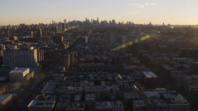 aerial of harlem, new york city skyline. multi-story and high rise office or apartment buildings. - ハーレム点の映像素材/bロール