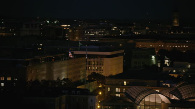 aerial of harry s. truman building, night washington d.c. - government building stock videos and b-roll footage