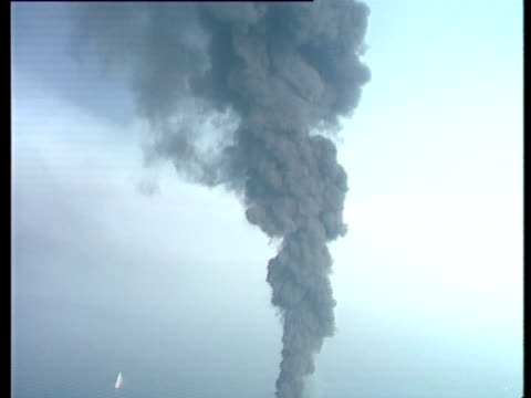 aerial of haven oil tanker on fire at sea with plumes of thick black smoke genoa, italy, mediterranean. - oil spill stock videos & royalty-free footage