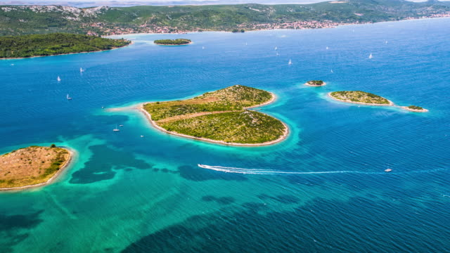 aerial of heart shaped island galesnjak in croatia - croazia video stock e b–roll
