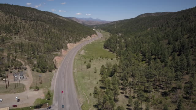aerial of highway in new mexico, tilt-up - native american reservation stock videos & royalty-free footage
