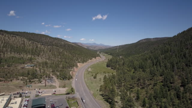 aerial of highway in valley of new mexico - native american reservation stock videos & royalty-free footage