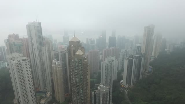 aerial of hong kong island skyscrapers from victoria peak in the fog no - victoria peak stock videos & royalty-free footage