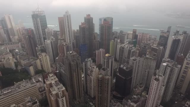 aerial of hong kong island skyscrapers towards victoria harbor. no audio - victoria harbour hong kong stock videos & royalty-free footage