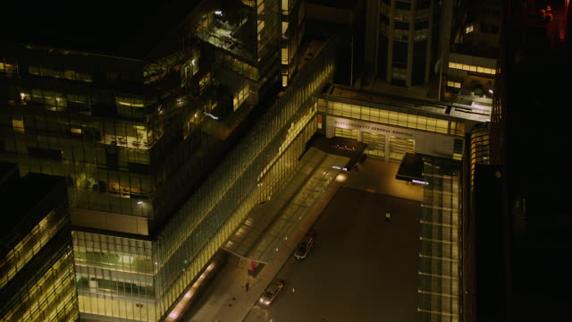 aerial of hospital in boston at night - medical building stock videos & royalty-free footage