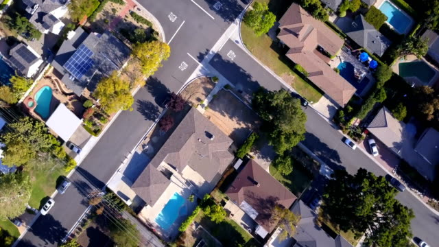 aerial of houses and trees in residential neighborhood - residential district stock videos & royalty-free footage