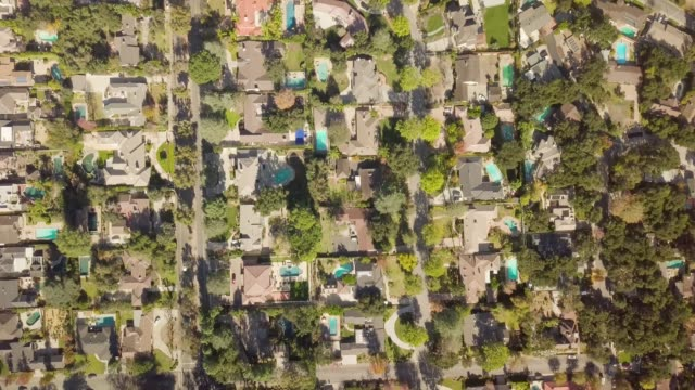 aerial of houses and trees in residential neighborhood - motorway junction stock videos & royalty-free footage