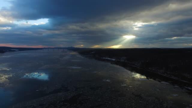 aerial of hudson river, sunlight bursting through dark sky - river hudson stock videos & royalty-free footage