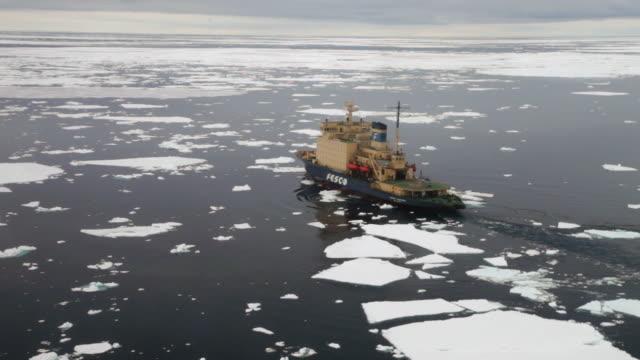 aerial of icebreaker kapitan khlebmikhov in antarctica breaking ice. various. (wobbly), ross sea, antarctica  - ross sea stock videos & royalty-free footage