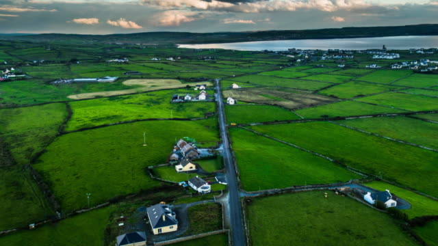aerial of idyllic rural landscape in ireland - patchwork landscape stock videos and b-roll footage