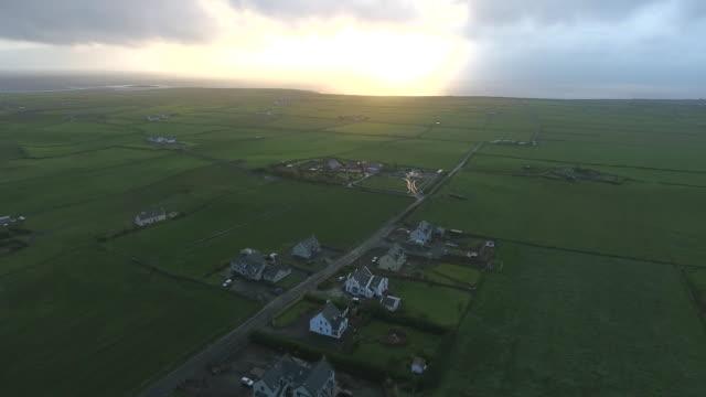 aerial of idyllic rural landscape in ireland - dorf stock-videos und b-roll-filmmaterial