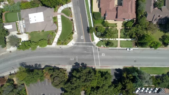 aerial of intersection with three way stop - road junction stock videos & royalty-free footage
