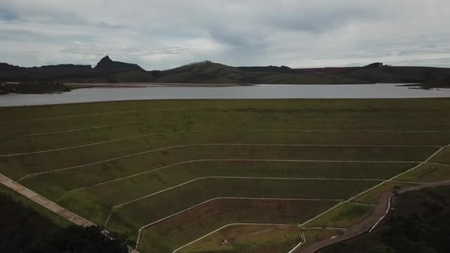 aerial of iron ore tailings maravilhas il dam a mining dam at itabirito in minas gerais brazil - iron ore stock videos & royalty-free footage