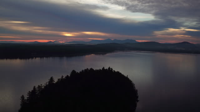 Aerial of island in the middle of Saranac lake at Sunrise