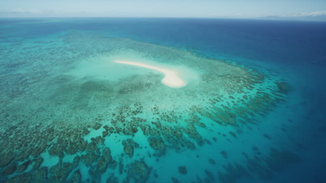 aerial of island on great barrier reef - reef stock videos and b-roll footage