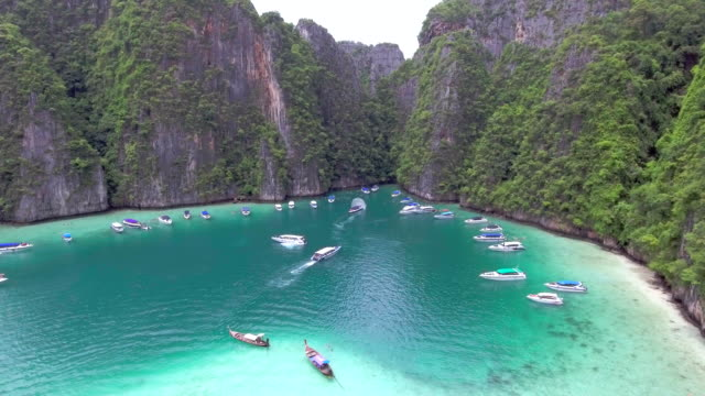aerial of island ,phi phi thailand - phuket stock videos & royalty-free footage