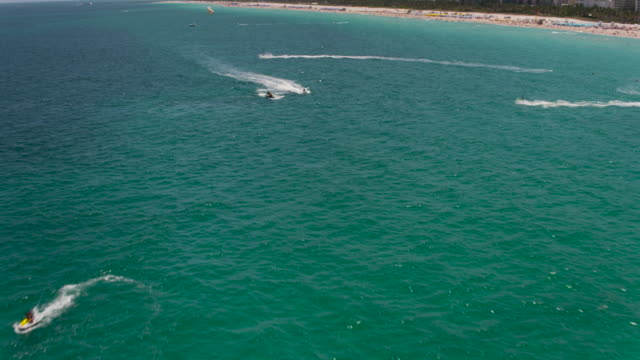 aerial of jet ski and parasailing, south beach miami - south beach stock videos & royalty-free footage