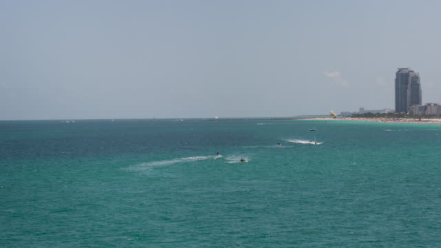 aerial of jet ski and parasailing, south beach miami - ski flying stock videos and b-roll footage