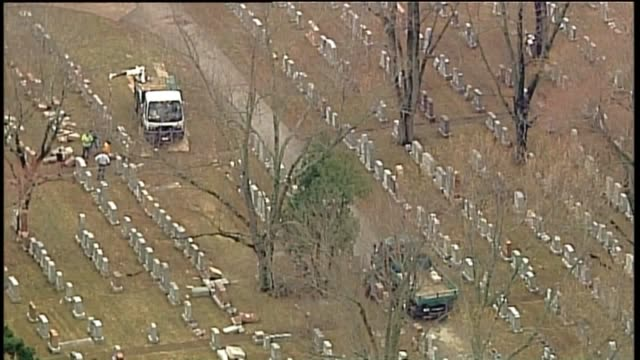 aerial of knocked over or damaged headstones at a historic jewish cemetery, chesed shel emeth cemetery, in st. louis's university city on feb. - cemetery stock videos & royalty-free footage