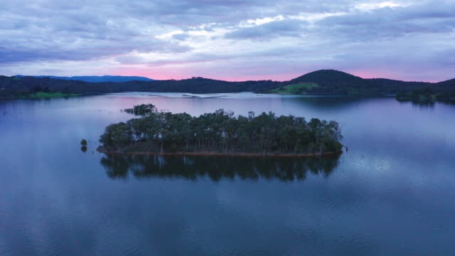 aerial of lake basin and island at sunrise - victoria australia stock videos & royalty-free footage