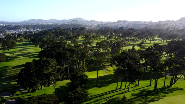 aerial of lake merced golf club - green golf course stock videos and b-roll footage