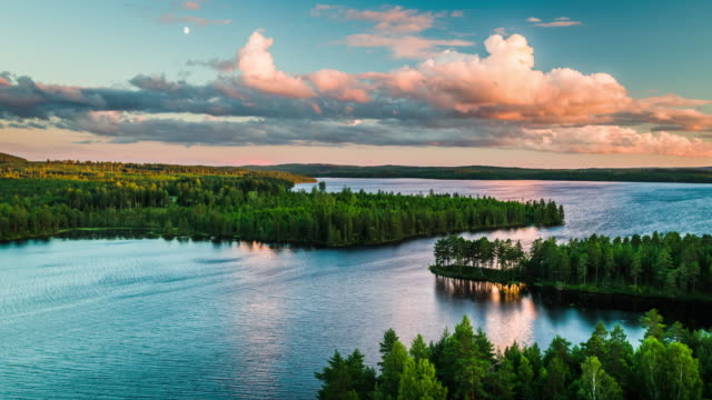 Aerial of landscape with lakes surrounded by forest in Sweden - 4K Nature/Wildlife/Weather