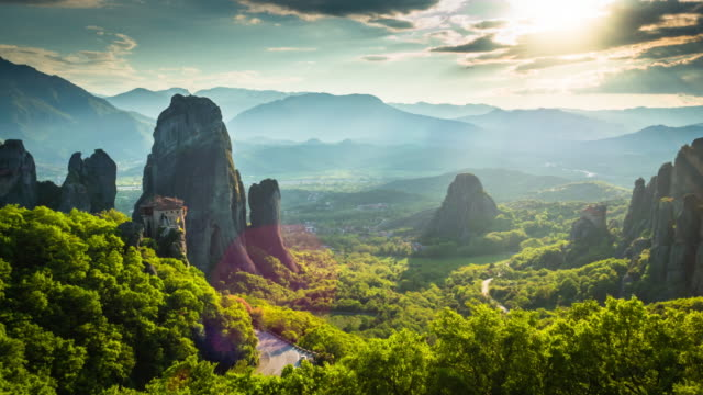 aerial of landscape with monasteries and rock formations in meteora, greece - light natural phenomenon stock videos & royalty-free footage