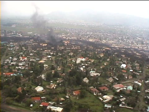 aerial of lava flow through town. goma 2002. drc - democratic republic of the congo stock videos & royalty-free footage