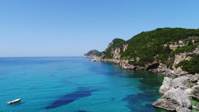aerial of liapades beach in corfu, ionian islands, greek islands, greece, europe - greece stock videos & royalty-free footage