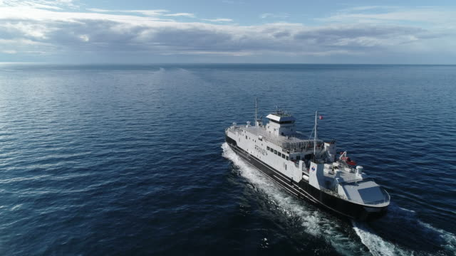 aerial of lofoten archipelago ferry at open sea, norway - ferry stock videos & royalty-free footage