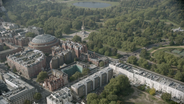 aerial of london. natural history museum, royal albert hall, hyde park. and the albert memorial visible. london skylines. - royal albert hall stock videos and b-roll footage