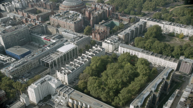 aerial of london. natural history museum, royal albert hall, hyde park. and the albert memorial visible. london skylines. - royal albert hall stock videos & royalty-free footage