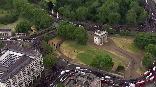aerial of london protest march over the death of george floyd an africanamerican who was killed when a policeman knelt on his neck whilst being... - north america stock videos & royalty-free footage