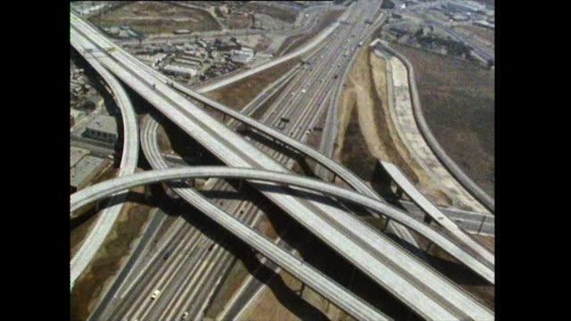 aerial of los angeles freeway interchange; 1972 - motorway junction stock videos & royalty-free footage