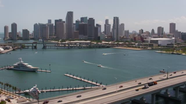 aerial of macarthur causeway, downtown miami sunny day miami fl - causeway stock videos & royalty-free footage