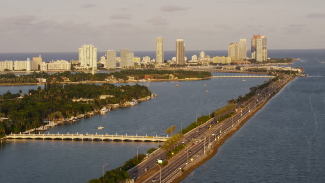 stockvideo's en b-roll-footage met aerial of macarthur causeway late afternoon miami fl - macarthur causeway bridge