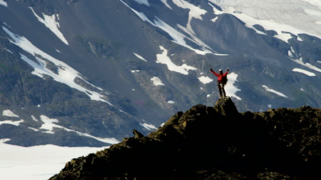 aerial of male mountain climber, alaska, usa - conquering adversity stock videos & royalty-free footage